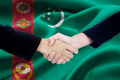 Business people and Turkmenistan flag Royalty Free Stock Photos