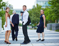 Business people turning around while walking Stock Photos