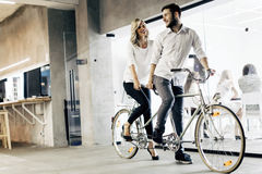 Business people on twin bicycle Stock Image