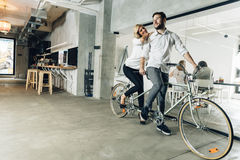 Business people on twin bicycle Royalty Free Stock Photo