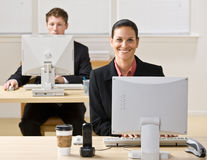 Business people typing on computers Royalty Free Stock Photo