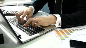 Business people typing on a laptop computer in the stock footage