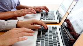 Business people typing on their laptops. On their desk stock video footage