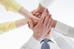 Business people uniting their hands - gesture of a uniion Stock Photo