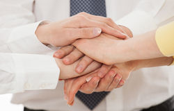 Business people uniting their hands - gesture of a uniion. White background royalty free stock photos