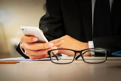 Business people use mobile phone in the office Stock Image