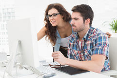 Business people using computer and digitizer Stock Image