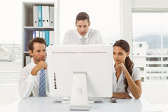 Business people using computer in office Stock Photos