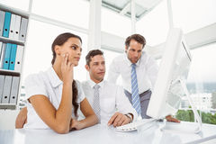 Business people using computer in office Stock Image