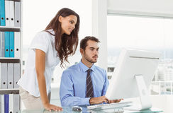 Business people using computer in office Stock Images