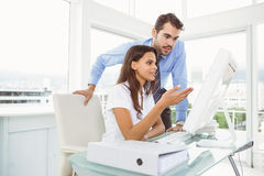 Business people using computer in office Royalty Free Stock Images