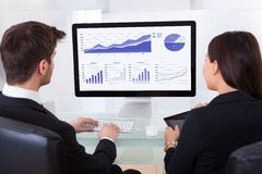 Business people using computer Stock Photography