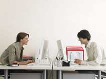 Business People Using Computers At Office Desks royalty free stock photo