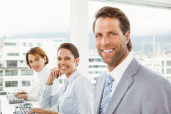 Business people using computers in office Royalty Free Stock Image