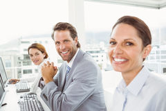 Business people using computers in office Stock Images