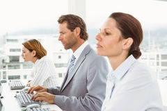 Business people using computers in office Stock Photo