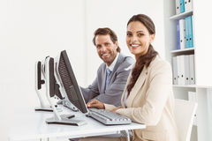 Business people using computers in office Stock Photography