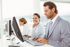 Business people using computers in office Stock Image