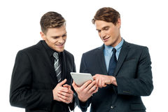 Business people using a digital tablet Royalty Free Stock Photos