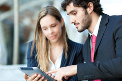 Business people using a digital tablet Royalty Free Stock Images