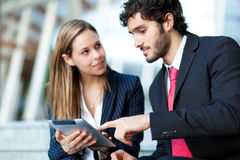 Business people using a digital tablet Royalty Free Stock Photo