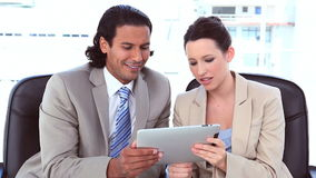 Business people using a digital tablet stock video