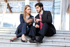 Business people using a digital tablet Stock Photos