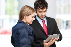Business people using a digital tablet Royalty Free Stock Photography