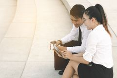 Business people using digital tablet at outside business office Stock Images