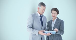 Business people using digital tablet over gray background Royalty Free Stock Photo