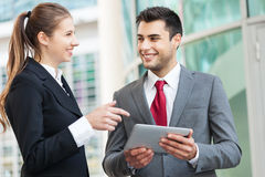 Business people using a digital tablet Stock Photo