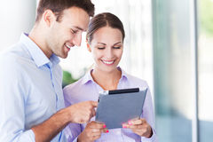 Business people using digital tablet together Stock Photo