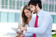 Business people using a digital tablet Stock Images