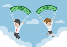 Business People Using Dollar Banknote as a Parachute Stock Photo