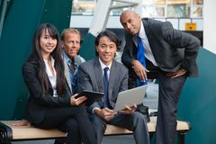Business people using electronic gadgets Stock Images