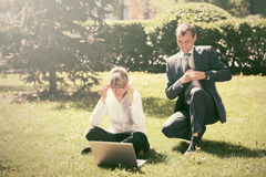 Business people using laptop in a city park Royalty Free Stock Photo