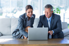 Business people using laptop computer Stock Images