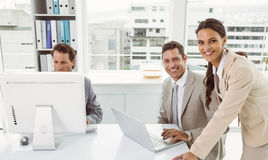 Business people using laptop and computer in office Stock Images