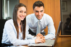 Business people using a laptop Royalty Free Stock Images