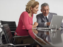 Business People Using Laptop In Conference Room Stock Images