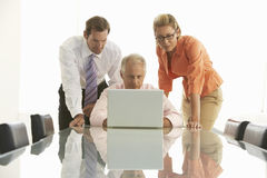 Business People Using Laptop In Conference Room Stock Photography