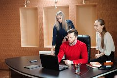 Business people using laptop at conference table. royalty free stock photos