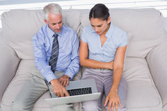 Business people using laptop on the couch Royalty Free Stock Photography