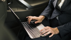 Business People Using Laptop Networking Car Inside Concept Royalty Free Stock Photos