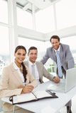 Business people using laptop in office Stock Photography