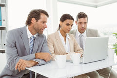 Business people using laptop in office Stock Photos