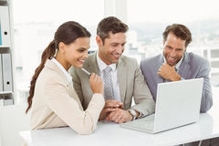 Business people using laptop in office Royalty Free Stock Photos