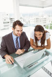 Business people using laptop in office Stock Image