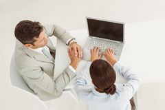 Business people using laptop in office Stock Images