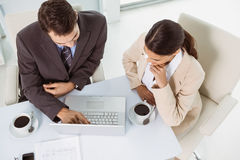 Business people using laptop in office Royalty Free Stock Image